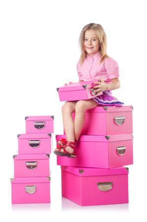 Little cute girl with lots of boxes photo