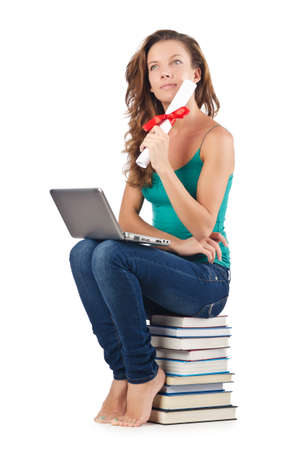 Student with netbook sitting on books Stock Photo - 18664592