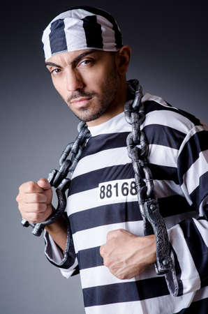 Convict criminal in striped uniform Stock Photo - 18664762