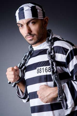 Convict criminal in striped uniform Stock Photo - 18664762