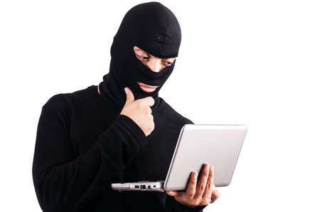 Hacker with computer wearing balaclava Stock Photo - 18664453