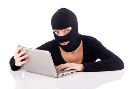 Hacker with computer wearing balaclava Stock Photo - 18664458