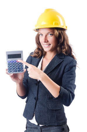 Female builder with calculator on white photo