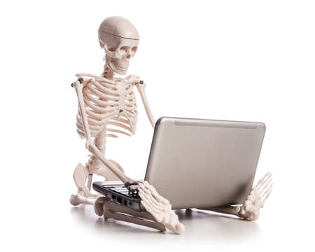 Skeleton working on laptop Stock Photo - 18608760