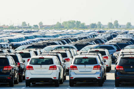 TUSCANY, ITALY - 27 June: New cars parked at distribution center in Tuscany, Italy. This one of biggest distribution centers in Italy. Stock Photo - 18613019