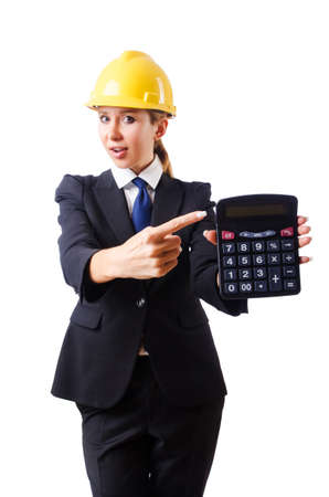 cost estimate: Female construction worker with calculator Stock Photo