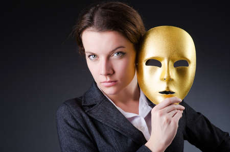 Woman with mask in hypocrisy concept Stock Photo - 18651389