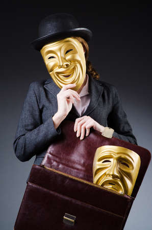 Woman with mask in hypocrisy concept Stock Photo - 18609521