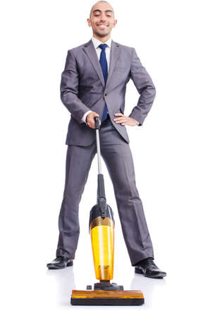 vacuum cleaning: Businessman doing vacuum cleaning on white