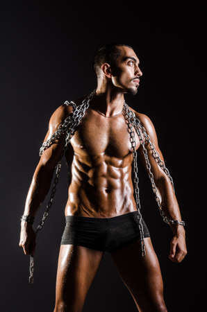 Muscular man with chain on black background Stock Photo - 18651041