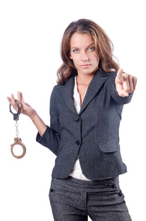 woman prison: Female businesswoman with handcuffs on white