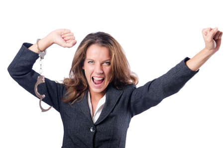 Female businesswoman with handcuffs on white Stock Photo - 18614861