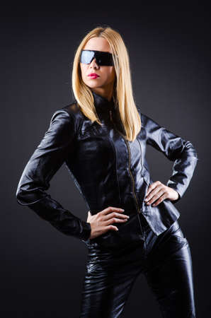 Attrative woman in leather suit photo