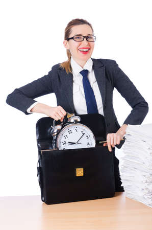 Woman businesswoman with giant alarm clock photo