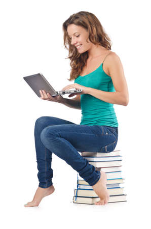 Student with netbook sitting on books Stock Photo - 18614870