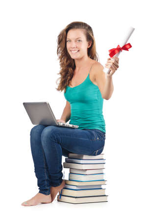 Student with netbook sitting on books Stock Photo - 18680118