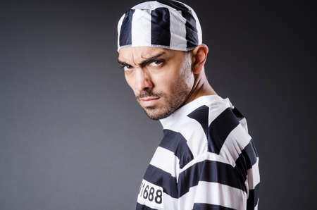 Convict criminal in striped uniform photo