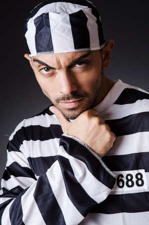 Convict criminal in striped uniform Stock Photo - 18680504