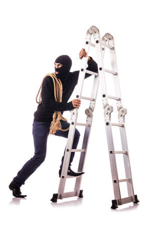 Burglar wearing balaclava isolated on white Stock Photo - 18679671