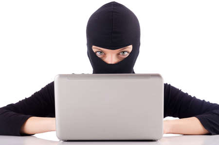 Hacker with computer wearing balaclava Stock Photo - 18680031
