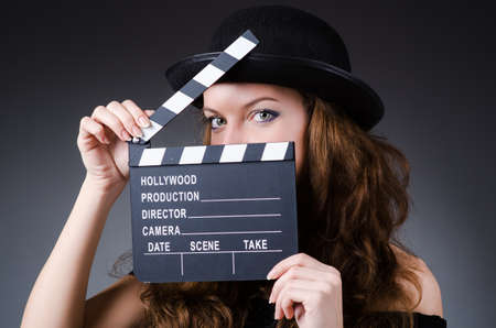 tophat: Woman with movie clapper board