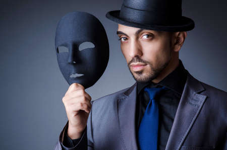 impostor: Man with black mask in studio
