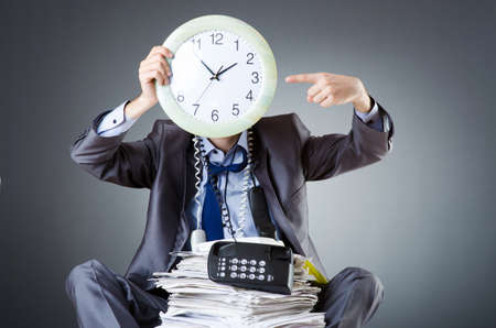 Man with clock and pile of papers Stock Photo - 18744926