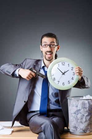 Man with clock and pile of papers Stock Photo - 18803321