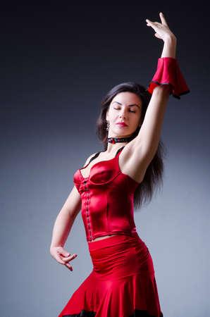 Female dancer dancing spanish dances photo