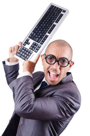 Nerd businessman with computer keyboard on white photo