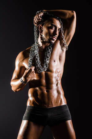 Muscular man with chain on black background Stock Photo - 18803241