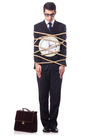 Businessman tied to clock on white Stock Photo - 18802688