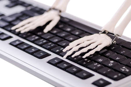 Skeleton working on the keyboard photo