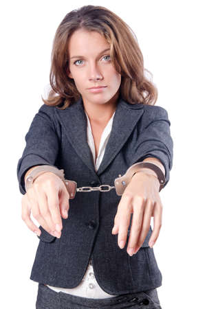 young  cuffs: Female businesswoman with handcuffs on white