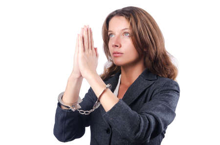 Female businesswoman with handcuffs on white Stock Photo - 18802962