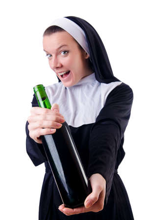 Nun with bottle of red wine Stock Photo - 18802827
