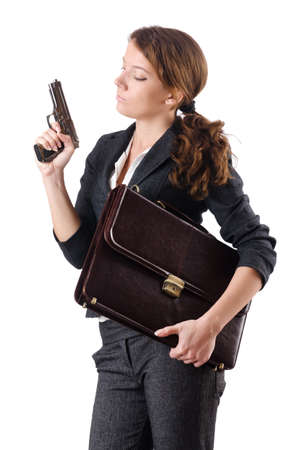 Woman businewoman with hand gun photo