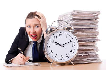 Woman businesswoman with giant alarm clock Stock Photo