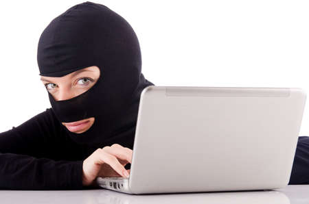Hacker with computer wearing balaclava Stock Photo - 18805039