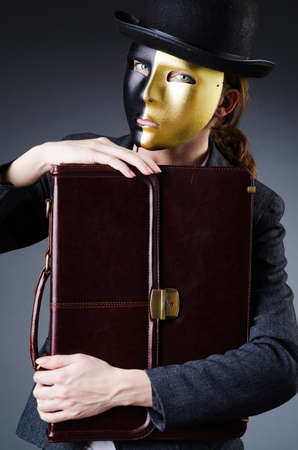 Woman with mask in hypocrisy concept Stock Photo - 19005707