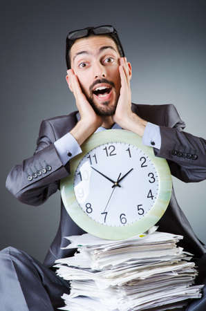 Man with clock and pile of papers Stock Photo - 19029195