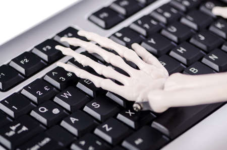Skeleton working on the keyboard Stock Photo - 19012764