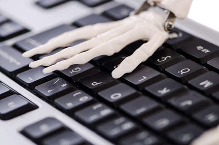 Skeleton working on the keyboard Stock Photo - 19012833