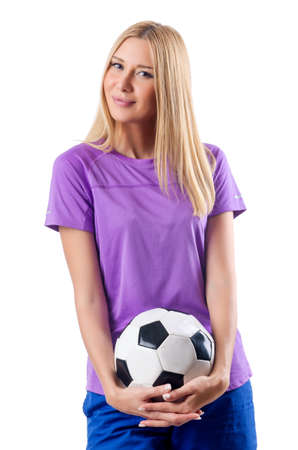 Woman playing football on white photo