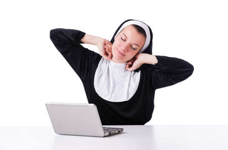 Nun working on laptop - religious concept Stock Photo - 19032457
