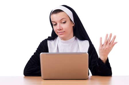 Nun working on laptop - religious concept photo