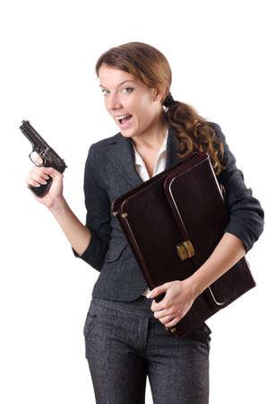 Woman businewoman with hand gun photo