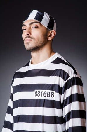 Convict criminal in striped uniform Stock Photo