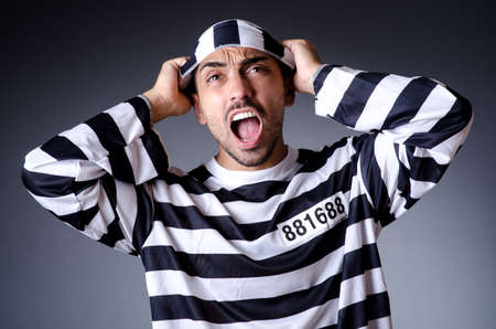 Convict criminal in striped uniform Stock Photo - 19032496