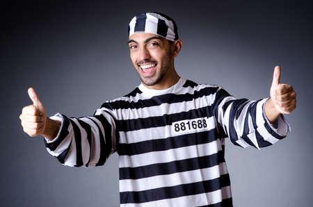 Convict criminal in striped uniform Stock Photo - 19032497